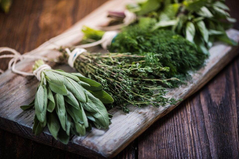 Herbs on a wooden board.