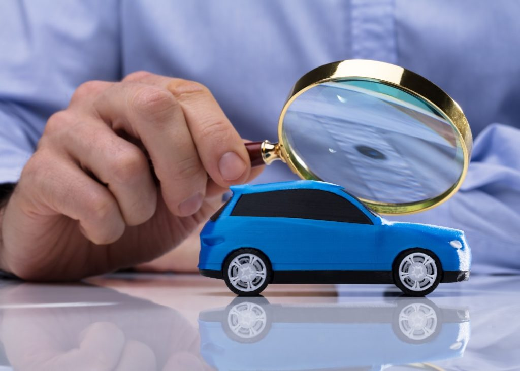 blue toy car under magnifying glass
