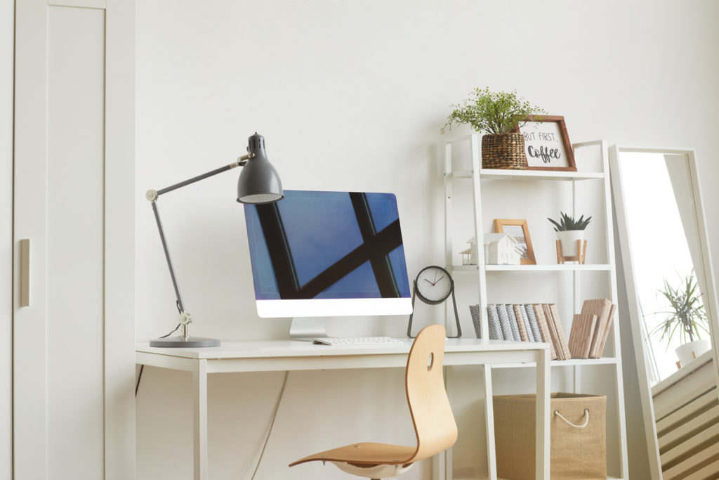 White Background image of empty home office workplace with wooden chair and modern computer on white desk, copy space